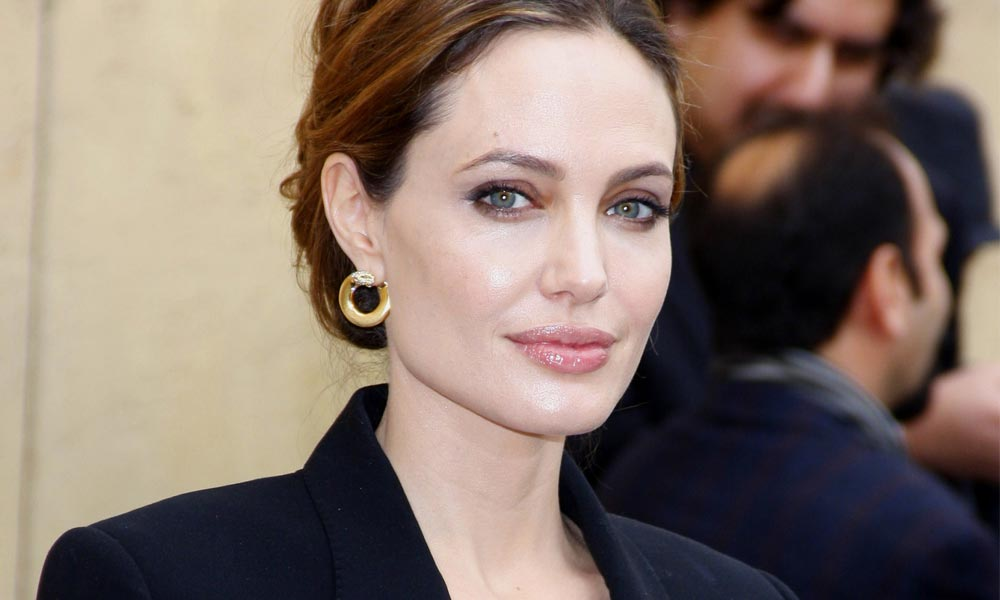 angelina jolie in a dark blazer with confident look after double mastectomy