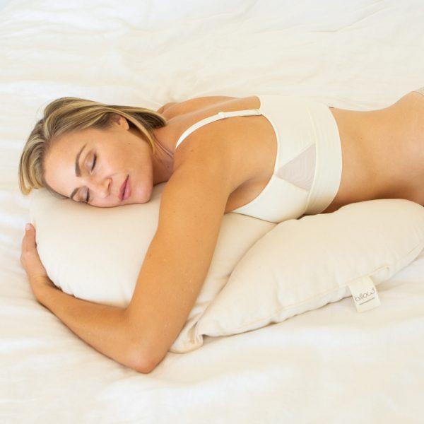 woman resting on billow pillow